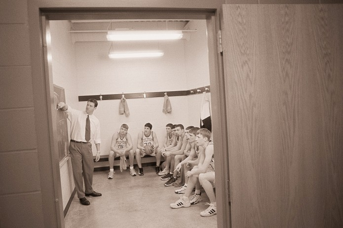 Coach Explaining a Play to the Basketball Team